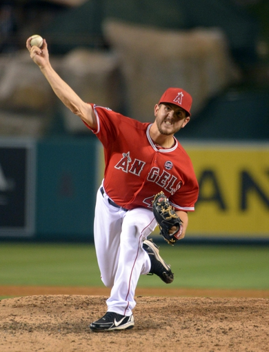 Sep 1, 2013; Anaheim, CA, USA; Los Angeles Angels reliever Cory Rasmus (46) delivers a pitch against the Tampa Bay Rays at Angel Stadium. Mandatory Credit: Kirby Lee-USA TODAY Sports