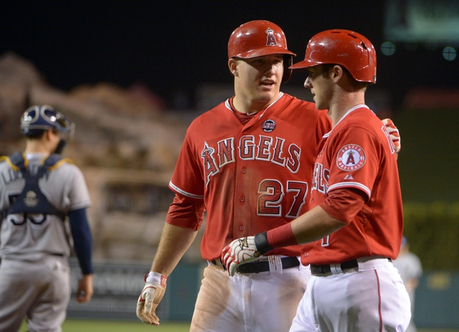 Sep 1, 2013; Anaheim, CA, USA; Los Angeles Angels left fielder Mike Trout (27) is congratulated by second baseman Andrew Romine (7) after scoring in the sixth inning against the Tampa Bay Rays at Angel Stadium. Mandatory Credit: Kirby Lee-USA TODAY Sports