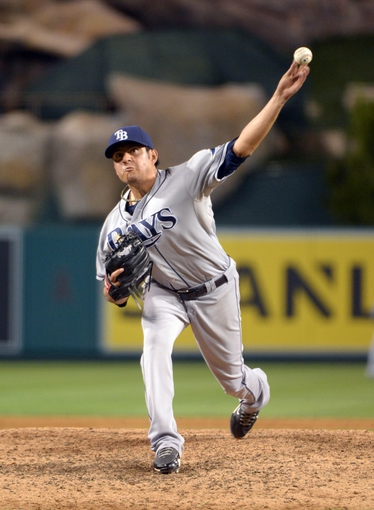 Sep 1, 2013; Anaheim, CA, USA; Tampa Bay Rays reliever Brandon Gomes (47) delivers a pitch against the Los Angeles Angels at Angel Stadium. Mandatory Credit: Kirby Lee-USA TODAY Sports