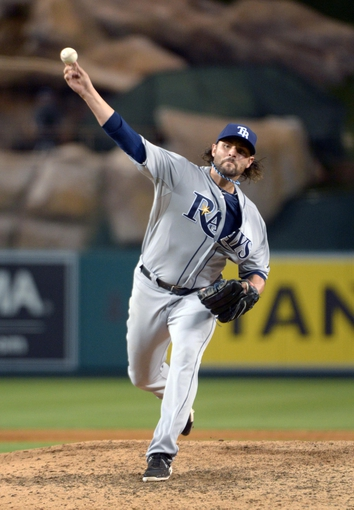 Sep 1, 2013; Anaheim, CA, USA; Tampa Bay Rays reliever Josh Lueke (52) delivers a pitch against the Los Angeles Angels at Angel Stadium. Mandatory Credit: Kirby Lee-USA TODAY Sports