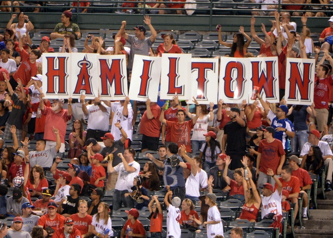 "Sep 1, 2013; Anaheim, CA, USA; Fans of Los Angeles Angels designated hitter Josh Hamlton (not pictured) spell out ""Hamiltown"" during the game against the Tampa Bay Rays at Angel Stadium. Mandatory Credit: Kirby Lee-USA TODAY Sports"