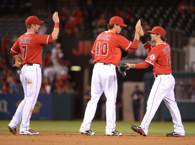 Sep 2, 2013; Anaheim, CA, USA; Los Angeles Angels players Andrew Romine (7), Grant Green (10) and Collin Cowgill (19) react at the end of the game against the Tampa Bay Rays at Angel Stadium. The Angels defeated the Rays 11-2. Mandatory Credit: Kirby Lee-USA TODAY Sports