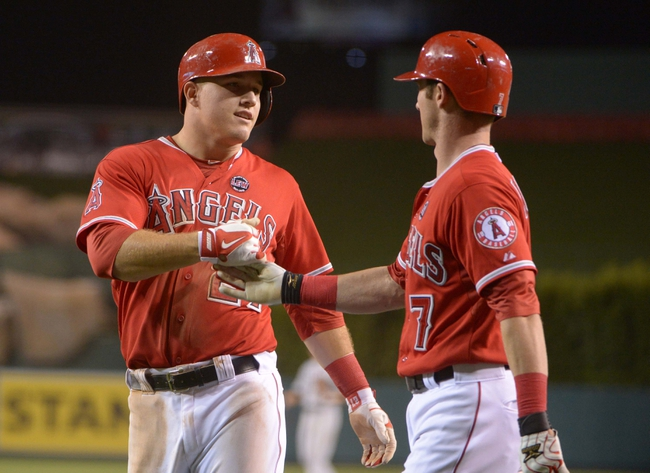 Sep 2, 2013; Anaheim, CA, USA; Los Angeles Angels left fielder Mike Trout (27) is congratulated by second baseman Andrew Romine (7) after scoring in the sixth inning against the Tampa Bay Rays at Angel Stadium. Mandatory Credit: Kirby Lee-USA TODAY Sports