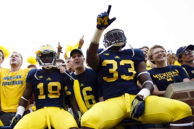 Aug 31, 2013; Ann Arbor, MI, USA; (Editors note: Caption correction) Michigan Wolverines defensive back Blake Countess (18) and defensive end Taco Charlton (33) celebrate with fans after the game against the Central Michigan Chippewas at Michigan Stadium. Michigan won 59-9. Mandatory Credit: Rick Osentoski-USA TODAY Sports