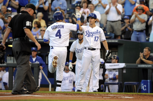 Sep 3, 2013; Kansas City, MO, USA; Kansas City Royals left fielder Alex Gordon (4) is congratulated by second baseman Chris Getz (17) after hitting a home run in the first inning against the Seattle Mariners at Kauffman Stadium. Mandatory Credit: John Rieger-USA TODAY Sports