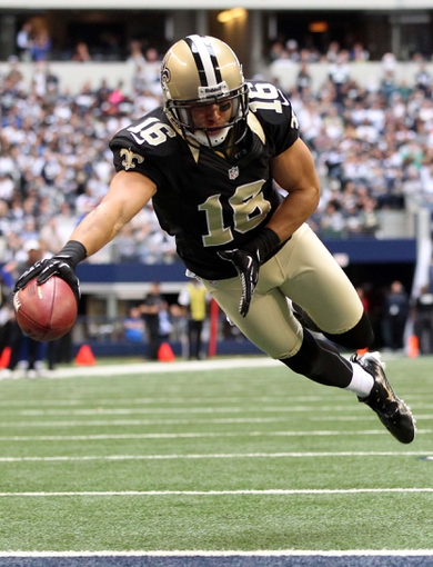 Dec 23, 2012; Arlington, TX, USA; New Orleans Saints wide receiver Lance Moore (16) dives for a touchdown in the second quarter against the Dallas Cowboys at Cowboys Stadium. Mandatory Credit: Tim Heitman-USA TODAY Sports