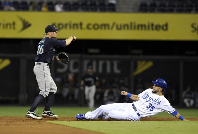 Sep 3, 2013; Kansas City, MO, USA; Kansas City Royals left fielder Alex Gordon (4) is out at second base as Seattle Mariners shortstop Brendan Ryan (26) throws to first base for a double play in the third inning at Kauffman Stadium. Mandatory Credit: John Rieger-USA TODAY Sports