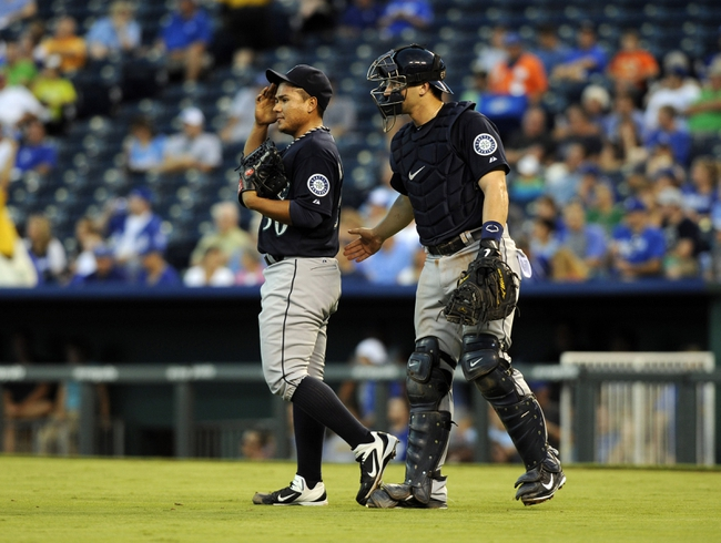 Sep 3, 2013; Kansas City, MO, USA; Seattle Mariners starting pitcher Erasmo Ramirez (50) talks to catcher Mike Zunino (3) against the Kansas City Royals in the second inning at Kauffman Stadium. Mandatory Credit: John Rieger-USA TODAY Sports