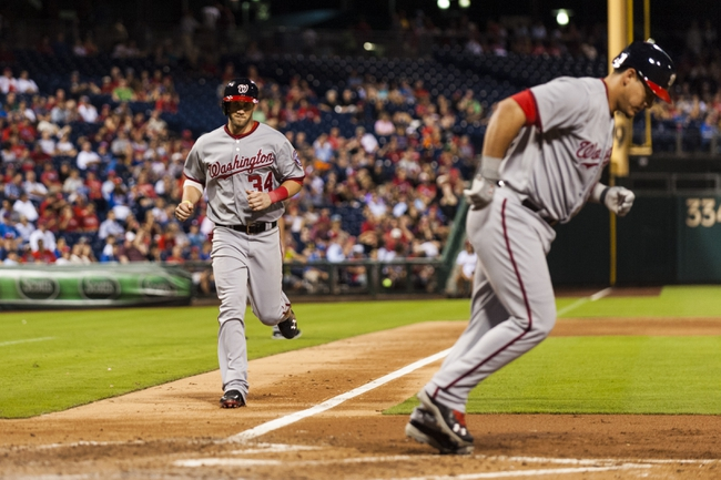 Sep 3, 2013; Philadelphia, PA, USA; Washington Nationals left fielder Bryce Harper (34) comes in to score as catcher Wilson Ramos (40) draws a bases loaded walk during the fifth inning against the Philadelphia Phillies at Citizens Bank Park. Mandatory Credit: Howard Smith-USA TODAY Sports