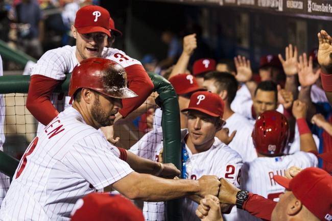 Sep 3, 2013; Philadelphia, PA, USA; Philadelphia Phillies first baseman Kevin Frandsen (28) celebrates scoring with teammates  during the fourth inning against the Washington Nationals at Citizens Bank Park. Mandatory Credit: Howard Smith-USA TODAY Sports