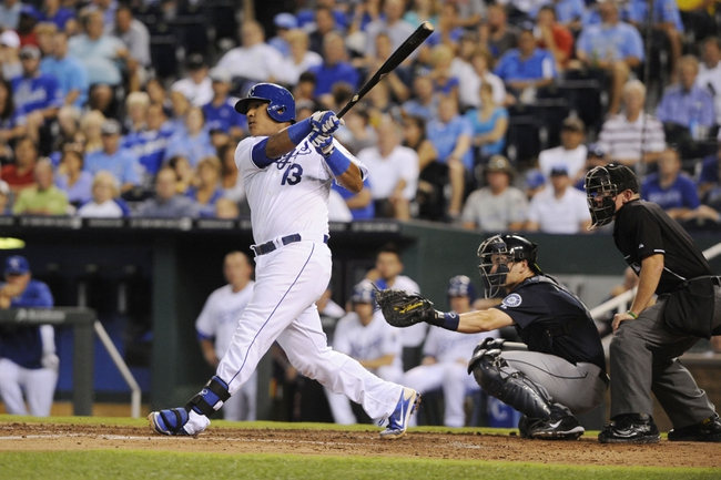 Sep 3, 2013; Kansas City, MO, USA; Kansas City Royals catcher Salvador Perez (13) hits a home run against the Seattle Mariners in the fourth inning at Kauffman Stadium. Mandatory Credit: John Rieger-USA TODAY Sports