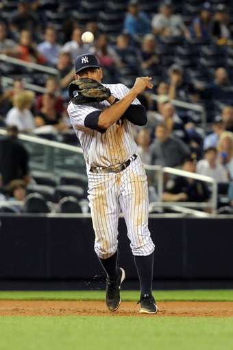 Sep 3, 2013; Bronx, NY, USA; New York Yankees third baseman Alex Rodriguez (13) throws out Chicago White Sox right fielder Jordan Danks (not pictured) during the sixth inning of a game at Yankee Stadium. Mandatory Credit: Brad Penner-USA TODAY Sports