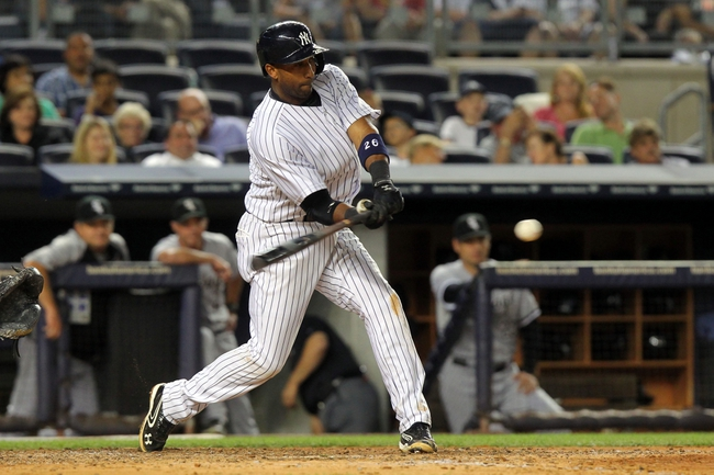 Sep 3, 2013; Bronx, NY, USA; New York Yankees shortstop Eduardo Nunez (26) hits a double against the Chicago White Sox during the fifth inning of a game at Yankee Stadium. Mandatory Credit: Brad Penner-USA TODAY Sports