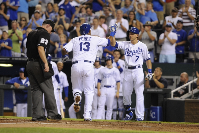 Sep 3, 2013; Kansas City, MO, USA; Kansas City Royals catcher Salvador Perez (13) is congratulated by right fielder David Lough (7) after hitting a home run against the Seattle Mariners in the fourth inning at Kauffman Stadium. Mandatory Credit: John Rieger-USA TODAY Sports