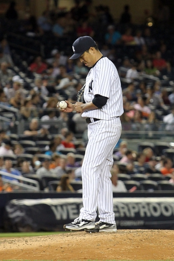 Sep 3, 2013; Bronx, NY, USA; New York Yankees starting pitcher Hiroki Kuroda (18) reacts after allowing a solo home run to Chicago White Sox center fielder Alejandro De Aza (not pictured) during the seventh inning of a game at Yankee Stadium. Mandatory Credit: Brad Penner-USA TODAY Sports