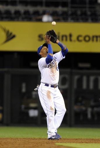 Sep 3, 2013; Kansas City, MO, USA; Kansas City Royals second baseman Emilio Bonifacio (64) catches a fly ball in the sixth inning against the Seattle Mariners at Kauffman Stadium. Mandatory Credit: John Rieger-USA TODAY Sports