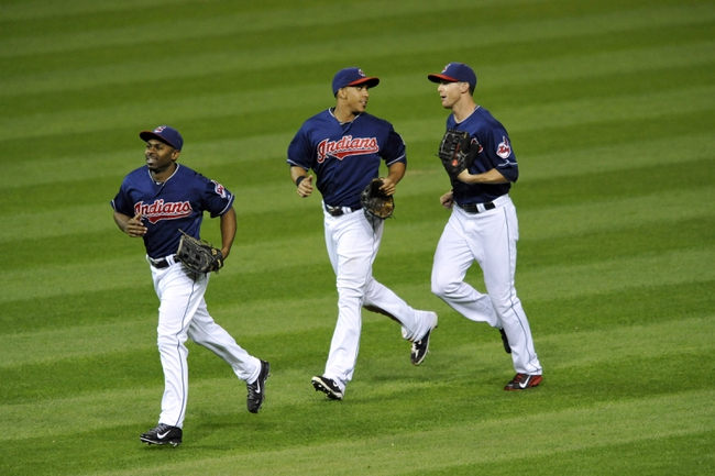 Sep 3, 2013; Cleveland, OH, USA; Cleveland Indians center fielder Michael Bourn (left), left fielder Michael Brantley (center) and right fielder Drew Stubbs celebrate a 4-3 win over the Baltimore Orioles at Progressive Field. Mandatory Credit: David Richard-USA TODAY Sports