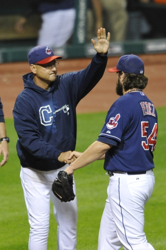 Sep 3, 2013; Cleveland, OH, USA; Cleveland Indians manager Terry Francona (left) and relief pitcher Chris Perez (54) celebrate a 4-3 win over the Baltimore Orioles at Progressive Field. Mandatory Credit: David Richard-USA TODAY Sports