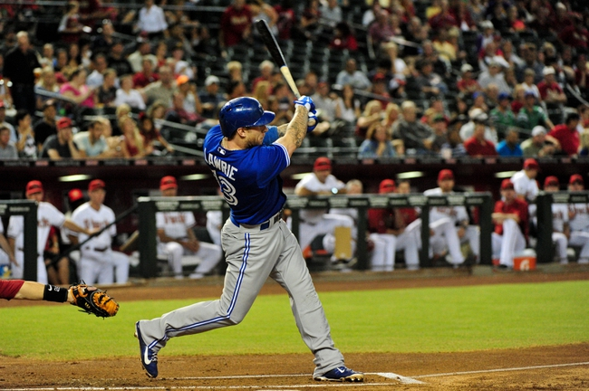 Sept 3, 2013; Phoenix, AZ, USA; Toronto Blue Jays third baseman Brett Lawrie (13) hits an RBI single in the first inning against the Arizona Diamondbacks at Chase Field. Mandatory Credit: Matt Kartozian-USA TODAY Sports