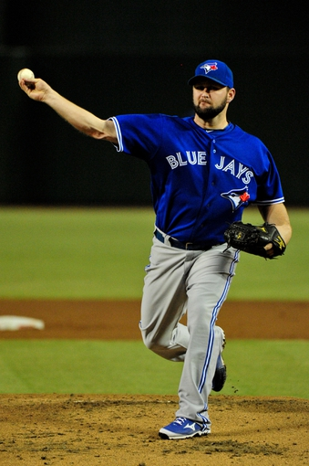 Sept 3, 2013; Phoenix, AZ, USA; Toronto Blue Jays starting pitcher Todd Redmond (58) warms up before the first inning against the Arizona Diamondbacks at Chase Field. Mandatory Credit: Matt Kartozian-USA TODAY Sports