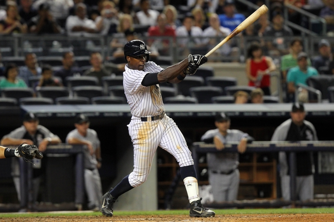 Sep 3, 2013; Bronx, NY, USA; New York Yankees left fielder Alfonso Soriano (12) hits a two-RBI single against the Chicago White Sox during the eighth inning of a game at Yankee Stadium. Mandatory Credit: Brad Penner-USA TODAY Sports
