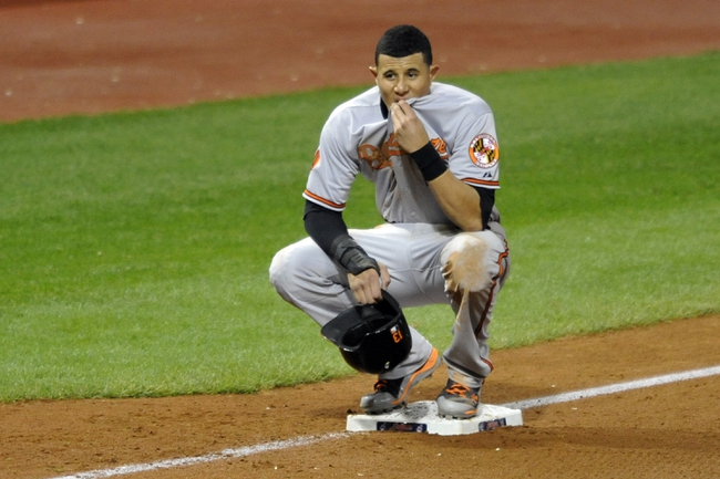Sep 3, 2013; Cleveland, OH, USA; Baltimore Orioles third baseman Manny Machado (13) stands on third base during a break in the action in the sixth inning against the Cleveland Indians at Progressive Field. Mandatory Credit: David Richard-USA TODAY Sports