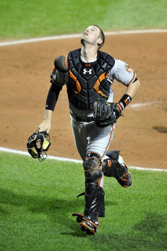 Sep 3, 2013; Cleveland, OH, USA; Baltimore Orioles catcher Matt Wieters (32) looks for a foul ball in the third inning against the Cleveland Indians at Progressive Field. Mandatory Credit: David Richard-USA TODAY Sports