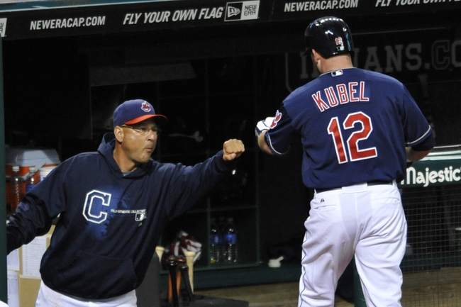 Sep 3, 2013; Cleveland, OH, USA; Cleveland Indians manager Terry Francona (left) celebrates with right fielder Jason Kubel (12) in the sixth inning at Progressive Field. Mandatory Credit: David Richard-USA TODAY Sports