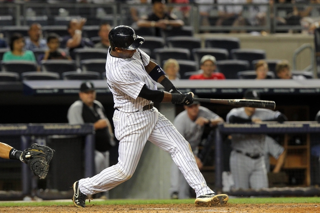 Sep 3, 2013; Bronx, NY, USA; New York Yankees shortstop Eduardo Nunez (26) hits a two-RBI go-ahead double against the Chicago White Sox during the eighth inning of a game at Yankee Stadium. Mandatory Credit: Brad Penner-USA TODAY Sports