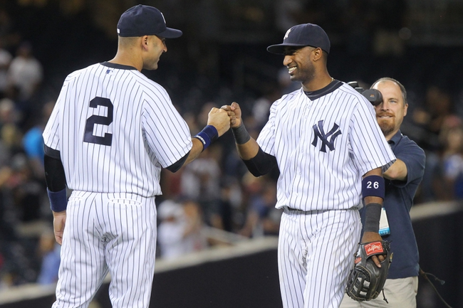 Sep 3, 2013; Bronx, NY, USA; New York Yankees shortstop Eduardo Nunez (26) and designated hitter Derek Jeter (2) celebrate after a game against the Chicago White Sox at Yankee Stadium. Mandatory Credit: Brad Penner-USA TODAY Sports