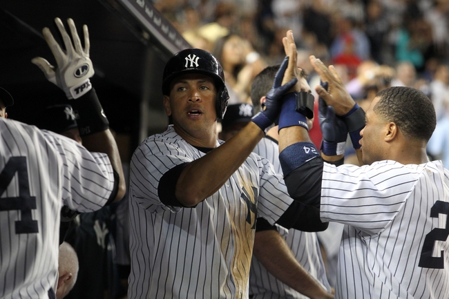 Sep 3, 2013; Bronx, NY, USA; New York Yankees third baseman Alex Rodriguez (13) and second baseman Robinson Cano (24) celebrate in the dugout during the ninth inning of a game against the Chicago White Sox at Yankee Stadium. Mandatory Credit: Brad Penner-USA TODAY Sports