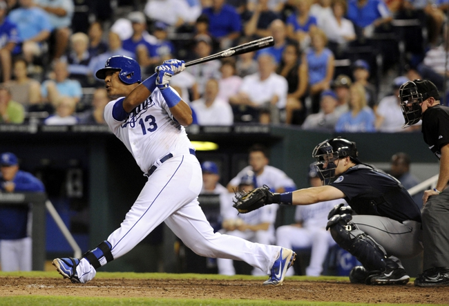 Sep 3, 2013; Kansas City, MO, USA; Kansas City Royals catcher Salvador Perez (13) drives in the winning run with a single in the eight inning at Kauffman Stadium. The Royals won the game 4-3. Mandatory Credit: John Rieger-USA TODAY Sports