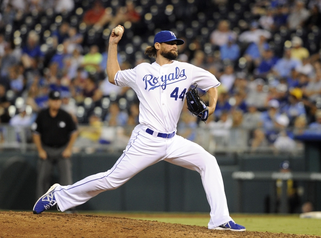 Sep 3, 2013; Kansas City, MO, USA; Kansas City Royals relief pitcher Luke Hochevar (44) delivers a pitch in the eighth inning against the Seattle Mariners at Kauffman Stadium. The Royals won the game 4-3. Mandatory Credit: John Rieger-USA TODAY Sports