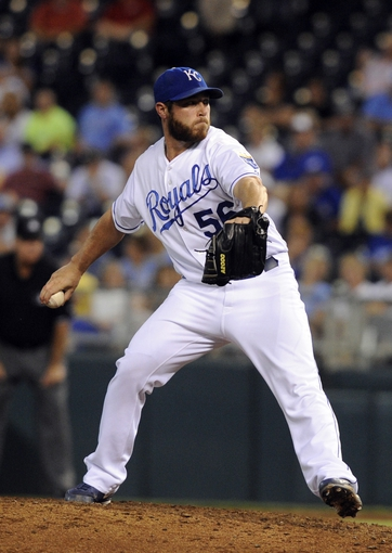 Sep 3, 2013; Kansas City, MO, USA; Kansas City Royals relief pitcher Greg Holland (56) delivers a pitch in the ninth inning against the Seattle Mariners at Kauffman Stadium. The Royals won the game 4-3. Mandatory Credit: John Rieger-USA TODAY Sports