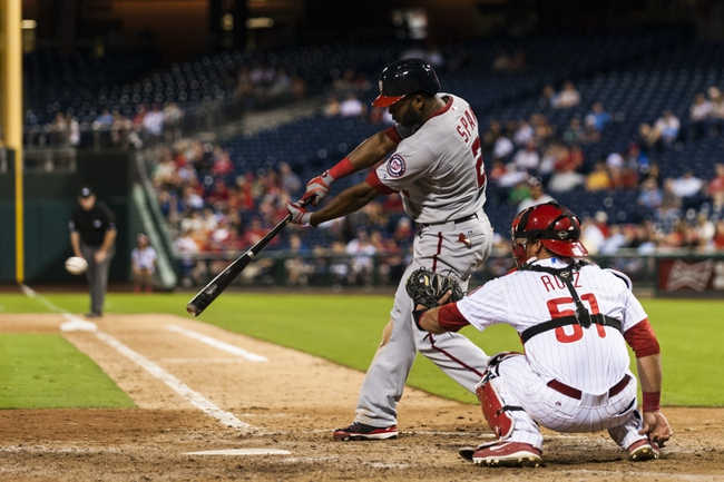 Sep 3, 2013; Philadelphia, PA, USA; Washington Nationals center fielder Denard Span (2) singles during the ninth inning against the Philadelphia Phillies at Citizens Bank Park. The Nationals defeated the Phillies 9-6. Mandatory Credit: Howard Smith-USA TODAY Sports