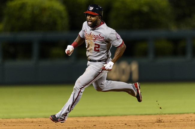 Sep 3, 2013; Philadelphia, PA, USA; Washington Nationals center fielder Denard Span (2) advances from first to third base during the ninth inning against the Philadelphia Phillies at Citizens Bank Park. The Nationals defeated the Phillies 9-6. Mandatory Credit: Howard Smith-USA TODAY Sports
