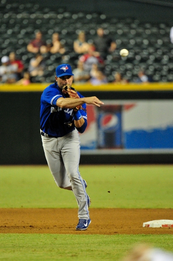 Sept 3, 2013; Phoenix, AZ, USA; Toronto Blue Jays second baseman Mark DeRosa (16) throws to first base during the fourth inning against the Arizona Diamondbacks at Chase Field. Mandatory Credit: Matt Kartozian-USA TODAY Sports