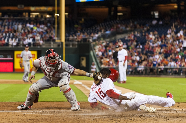 Sep 3, 2013; Philadelphia, PA, USA; Philadelphia Phillies right fielder John Mayberry (15) beats the tag of Washington Nationals catcher Wilson Ramos (40) to score during the sixth inning at Citizens Bank Park. The Nationals defeated the Phillies 9-6. Mandatory Credit: Howard Smith-USA TODAY Sports