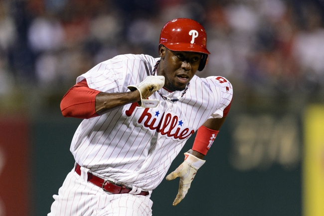 Sep 3, 2013; Philadelphia, PA, USA; Philadelphia Phillies right fielder John Mayberry (15) rounds third base on his way to scoring during the sixth inning against the Washington Nationals at Citizens Bank Park. The Nationals defeated the Phillies 9-6. Mandatory Credit: Howard Smith-USA TODAY Sports