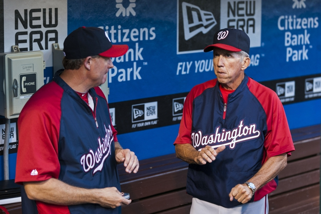 Sep 3, 2013; Philadelphia, PA, USA; Washington Nationals bench coach Randy Knorr (left) talks with manager Davey Johnson (right) in the dugout prior to playing the Philadelphia Phillies at Citizens Bank Park. The Nationals defeated the Phillies 9-6. Mandatory Credit: Howard Smith-USA TODAY Sports