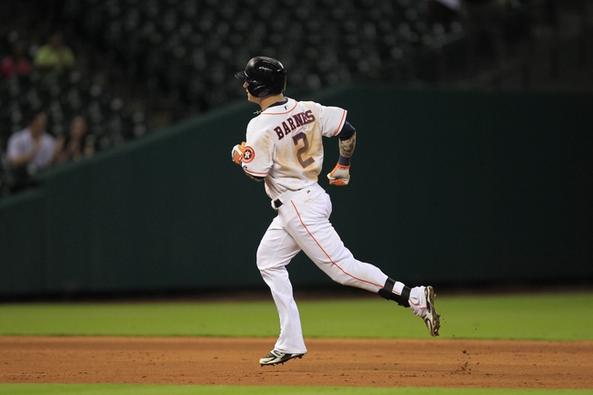 Sep 3, 2013; Houston, TX, USA; Houston Astros center fielder Brandon Barnes (2) circles the bases after hitting a three-run home run to tie the game against the Minnesota Twins during the ninth inning at Minute Maid Park. Mandatory Credit: Thomas Campbell-USA TODAY Sports