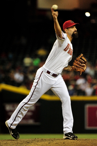 Sept 3, 2013; Phoenix, AZ, USA; Arizona Diamondbacks relief pitcher Chaz Roe (34) throws to first base during the sixth inning against the Toronto Blue Jays at Chase Field. Mandatory Credit: Matt Kartozian-USA TODAY Sports