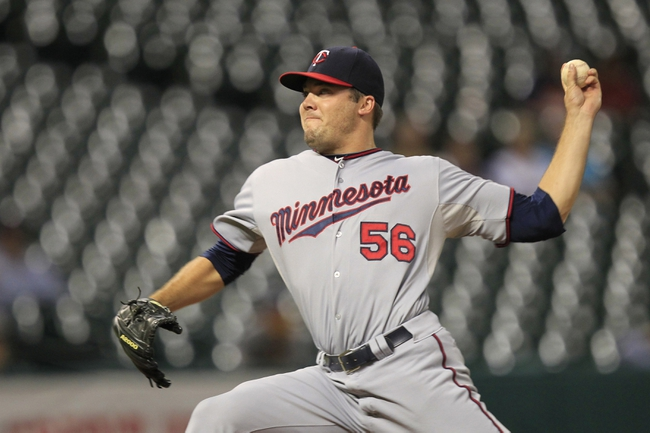 Sep 3, 2013; Houston, TX, USA; Minnesota Twins relief pitcher Caleb Thielbar (56) pitches against the Houston Astros during the eleventh inning at Minute Maid Park. Mandatory Credit: Thomas Campbell-USA TODAY Sports