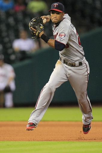 Sep 3, 2013; Houston, TX, USA; Minnesota Twins shortstop Pedro Florimon (25) throws out a runner against the Houston Astros during the eleventh inning at Minute Maid Park. Mandatory Credit: Thomas Campbell-USA TODAY Sports
