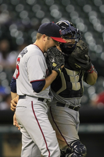 Sep 3, 2013; Houston, TX, USA; Minnesota Twins relief pitcher Caleb Thielbar (56) talks to catcher Josmil Pinto (43) against the Houston Astros during the eleventh inning at Minute Maid Park. Mandatory Credit: Thomas Campbell-USA TODAY Sports