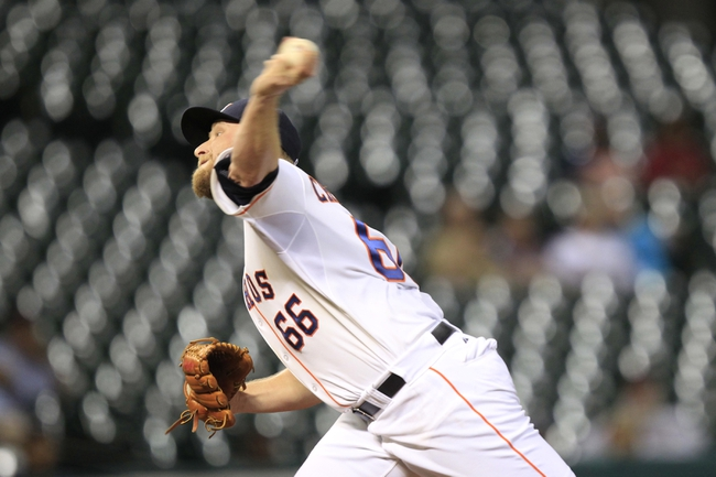 Sep 3, 2013; Houston, TX, USA; Houston Astros relief pitcher Kevin Chapman (66) pitches against the Minnesota Twins during the twelfth inning at Minute Maid Park. The Twins won 9-6. Mandatory Credit: Thomas Campbell-USA TODAY Sports