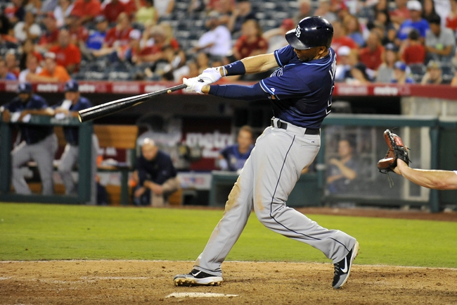 September 3, 2013; Anaheim, CA, USA; Tampa Bay Rays first baseman James Loney (21) at bat in the eighth inning against the Los Angeles Angels at Angel Stadium of Anaheim. Mandatory Credit: Gary A. Vasquez-USA TODAY Sports