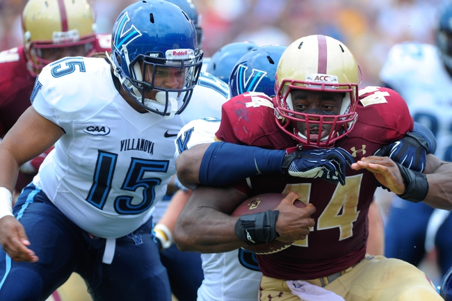 Aug 31, 2013; Boston, MA, USA; Boston College Eagles running back Andre Williams (44) is tackled during the first half against the Villanova Wildcats at Alumni Stadium. Mandatory Credit: Bob DeChiara-USA TODAY Sports