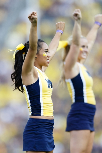 Aug 31, 2013; Ann Arbor, MI, USA; Michigan Wolverines cheerleader during the game against the Central Michigan Chippewas at Michigan Stadium. Mandatory Credit: Rick Osentoski-USA TODAY Sports