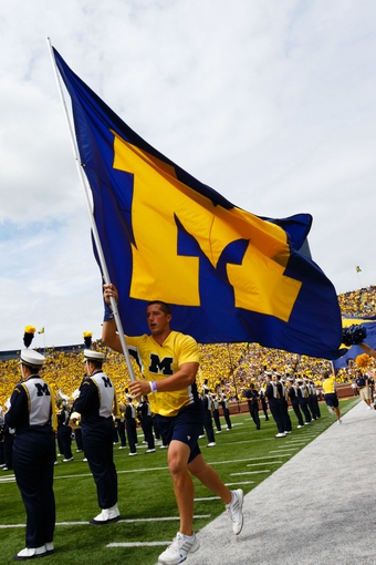 Aug 31, 2013; Ann Arbor, MI, USA; Michigan Wolverines marching bands enters the field before the game against the Central Michigan Chippewas at Michigan Stadium. Mandatory Credit: Rick Osentoski-USA TODAY Sports